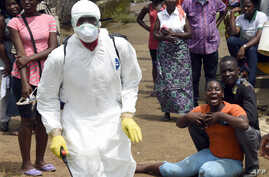A woman reacts after her husband is suspected of dying from the Ebola virus, in the Liberian capital Monrovia, on October 4, 2014.