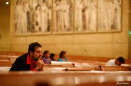 Ernesto Vega, of the archdiocese of Los Angeles Hispanic ministry, listens as Los Angeles Catholic Archbishop Jose Gomez leads an interfaith prayer service for the immigrant community following the election of Republican Donald Trump, in Los Angeles,