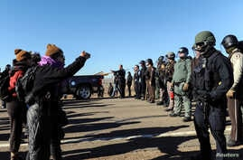 Police block the highway from protesters next to the pipeline route during a protest against the Dakota Access pipeline near the Standing Rock Sioux Reservation in St. Anthony, North Dakota, U.S. Nov. 11, 2016.