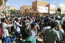 Sudanese protesters chant slogans during an anti-government demonstration in the capital Khartoum, Jan. 6, 2019.