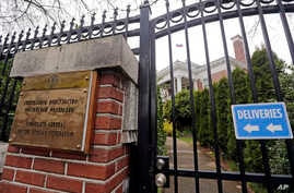 A metal fence surrounds the residence of Russia's consul general Monday, March 26, 2018, in Seattle. The United States and more than a dozen European nations kicked out Russian diplomats on Monday and the Trump administration ordered Russia's consula