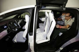 The Tesla Model X car, with a third row of seats, is introduced at the company's headquarters, Sept. 29, 2015, in Fremont, Calif.