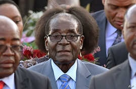 Zimbabwean president, Robert Mugabe, center, arrives in Pretoria, South Africa Tuesday, April 7, 2015 for a state visit to the country.. Mugabe will be in the country until Thursday and will meet with South African president Jacob Zuma Wednesday.(AP