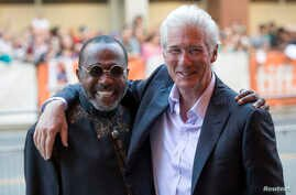 """Richard Gere hugs Ben Vereen (R) as they arrive for the """"Time Out of Mind"""" gala at the Toronto International Film Festival (TIFF) in Toronto, Canada, Sept. 7, 2014."""