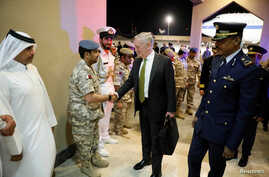 FILE - U.S. Defense Secretary James Mattis, center, is greeted by military dignitaries as he arrives at Al Udeid Air Base in Doha, Qatar, April 21, 2017