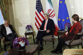 U.S. Secretary of State John Kerry (C), European Union (EU) High Representative for Foreign Affairs Catherine Ashton (R) and Iranian Foreign Minister Mohammad Javad Zarif participate in a trilateral meeting at the Waldorf Astoria hotel in New York, S