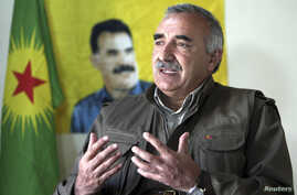 Murat Karayilan, acting military commander of the Kurdistan Workers Party (PKK), speaks during an interview with Reuters at the Qandil mountains near the Iraq-Turkish border in Sulaimaniya, 330 km (205 miles) northeast of Baghdad, Mar. 24, 2013.