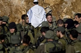 Israeli Troops Clash with Protesters Along Borders
