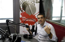 Greece's Prime Minister Alexis Tsipras gives an interview to the radio station ''Sto Kokkino 1055'' in Athens, July 29, 2015.