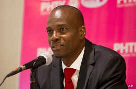 FILE - Presidential candidate Jovenel Moise, from the PHTK political party, gives a press conference in Port-au-Prince, Haiti, Oct. 19, 2015.