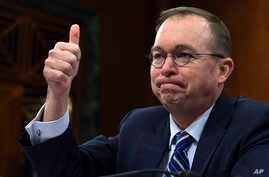 """Budget director Mick Mulvaney testifies before the Senate Budget Committee on Capitol Hill in Washington, Feb. 13, 2018. The Trump administration is pushing a """"bold new approach to nutrition assistance"""" — replacing the traditional cash on a card that"""