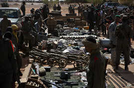 Weapons, munitions, seized from radical Islamist rebels are displayed at French army base in Gao, Mali,  Feb. 24, 2013