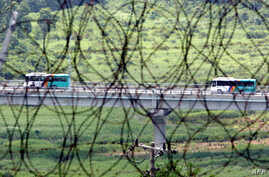 FILE - South Korean buses are seen transporting tourists near the border in Goseong, east of Seoul, from the North's Kumgang resort on July 13, 2008.