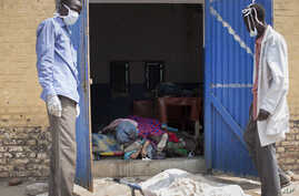 Staff open the doors of the morgue at the teaching hospital to add another body to the 24 already there, 20 of whom were killed from violence according to the staff, in Malakal, Upper Nile State, in South Sudan Tuesday, Jan. 21, 2014