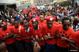 FILE - Ugandan musician turned politician, Robert Kyagulanyi (C) leads activists during a demonstration against new taxes, including a levy on access to social media platforms, in Kampala, Uganda, July 11, 2018.