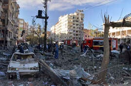People assess the damage after an explosion in southeastern Turkish city of Diyarbakir, early Nov. 4, 2016. A large explosion hit the largest city in Turkey's mainly Kurdish southeast region on Friday, wounding several people.