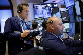 Traders work on the floor at the New York Stock Exchange in New York, July 8, 2015. (AP)