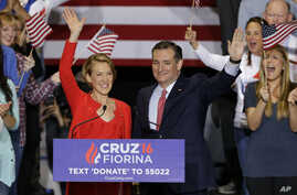 Republican presidential candidate Sen. Ted Cruz, R-Texas, joined by former Hewlett-Packard CEO Carly Fiorina, waves during a rally in Indianapolis, April 27, 2016, when Cruz announced he has tapped Fiorina to serve as his running mate.