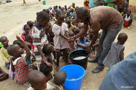 Children rescued from Boko Haram in Sambisa forest wash their hands at the Malkohi camp for Internally Displaced People in Yola, Adamawa State, Nigeria, May 3, 2015.