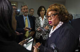 FILE - In this Aug. 13, 2015 file photo, Corrine Brown talks with the press in Tallahassee, Fla.