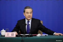 China's Foreign Minister Wang Yi attends a news conference during the ongoing National People's Congress (NPC), China's parliamentary body, in Beijing, China, March 8, 2018.