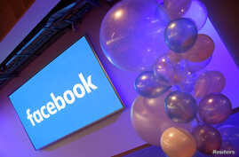 FILE - Balloons are seen in front of a logo at Facebook's headquarters in London, Dec. 4, 2017.
