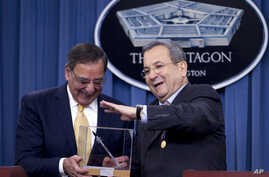 Israeli Defense Minister Ehud Barak presents Defense Secretary Leon Panetta with a model replica of an Iron Dome Missile Defense rocket during their joint news conference at the Pentagon, Thursday, Nov. 29, 2012.