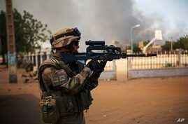 A French soldier battles radical Islamic rebels in Gao, Mali, Thursday, Feb. 21, 2013. Islamic extremists clashed with military in Mali's northern city of Gao, a military official said Thursday, as French and Malian forces continued their push to eli