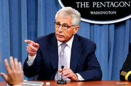 U.S. Secretary of Defense Chuck Hagel speaks during a press briefing at the Pentagon in Washington, August 21, 2014.