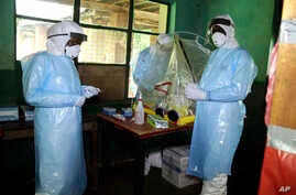 Health care workers wear virus protective gear at a treatment center in Bikoro Democratic Republic of Congo,May 13, 2018.