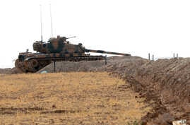 A Turkish tank is stationed near the Syrian border, in Karkamis, Turkey, Aug. 29, 2016.