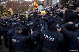 Catalan regional police officers scuffle with protesters in front of the Museum of Leida after police entered the museum to carry out an order and return over 40 contested artworks to the Spanish region of Aragon following a protracted legal battle i