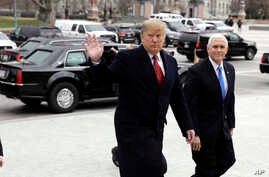 President Donald Trump arrives with Vice President Mike Pence to attend a Senate Republican policy lunch on Capitol Hill in Washington.