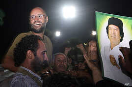 Seif al-Islam Gadhafi, top left, gestures to troops loyal to his father in Tripoli, Libya, August 23, 2011 (file photo).