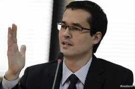 Brazilian prosecutor Deltan Dallagnol speaks during the announcement of the proposals by the Federal Public Ministry to combat corruption in Brazil, in Brasilia, March 20, 2015.