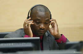 FILE - Germain Katanga, a Congolese national, sits in the courtroom of the ICC during the closing statements in the trial against Katanga and Ngudjolo Chui in The Hague.