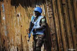 FILE - A Nigerian United Nations peacekeeper stands guard at a rally for incumbent Liberian President Ellen Johnson-Sirleaf in Monrovia.