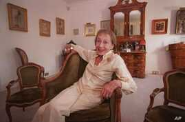 FILE - Actress Luise Rainer poses in her central London apartment, July 29, 1999.