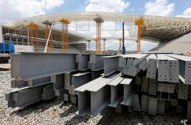 Steel beams sit outside the Arena de Sao Paulo in Sao Paulo, Brazil, Dec. 8, 2013.