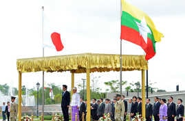 Japanese Prime Minister Shinzo Abe and Burma's President Thein Sein, take a salute of the honor guard  at Presidential Palace, in Naypyitaw, Burma, May 26, 2013.