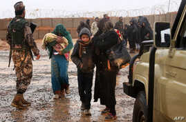 FILE - Syrian refugees are seen at Rukban camp, located in a no-man's-land on the border between Syria and Jordan, March 1, 2017
