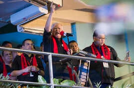 Malaysian Prime Minister Najib Razak (center) speaks to the crowd during a protest against the persecution of Rohingya Muslims in Myanmar, at a stadium in Kuala Lumpur, Malaysia, Dec. 4, 2016.