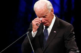 Former Vice President Joe Biden wipes a tear away while giving a tribute during memorial service at North Phoenix Baptist Church for Sen. John McCain, R-Ariz., on Aug. 30, 2018, in Phoenix, Arizona.