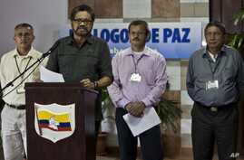 FILE - Jairo Martinez, right, is pictured with fellow FARC negotiators Ivan Marquez, left, and Yuri Camargo at a news conference in Havana, March 30, 2014.