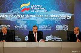 Venezuela's Vice President Tareck El Aissami, center, speaks during a meeting with bondholders and their representatives in Caracas, Nov. 13, 2017.