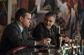 """Film image released by Columbia Pictures shows Matt Damon, left, and George Clooney in """"The Monuments Men."""""""
