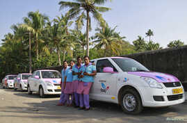 Female drivers from the 'She Taxi' service pose next to a taxi on a road in the southern Indian city of Kochi, Dec.12, 2014.