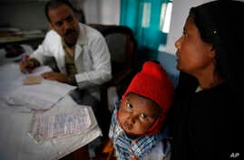 Anwar, 4, gets treated for tuberculosis at the Kashi Vidyapith block hospital near Varanasi, India, Feb. 1, 2014. The country has the world's highest incidence of TB. Researchers have unveiled an affordable, child-friendly medicine to combat the dise