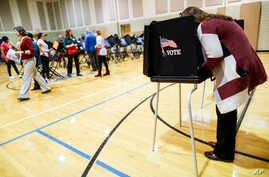 Voters cast their ballots at the Whetstone Community Center polling location, Nov. 6, 2018, in Columbus, Ohio.