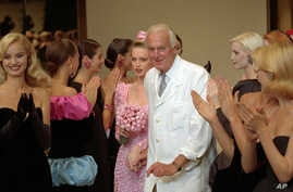 French designer Hubert de Givenchy, seen in this July 1995 photo, is applauded by his models after his 1995-96 fall-winter haute couture fashion collection in Paris. French couturier Hubert de Givenchy, a pioneer of ready-to-wear who designed Audrey